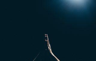 person raising arms